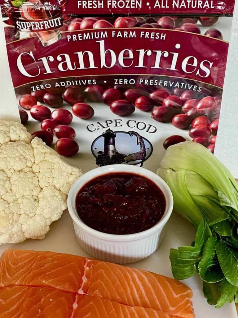 ingredients include salmon, cauliflower, cranberry glaze and bok choy