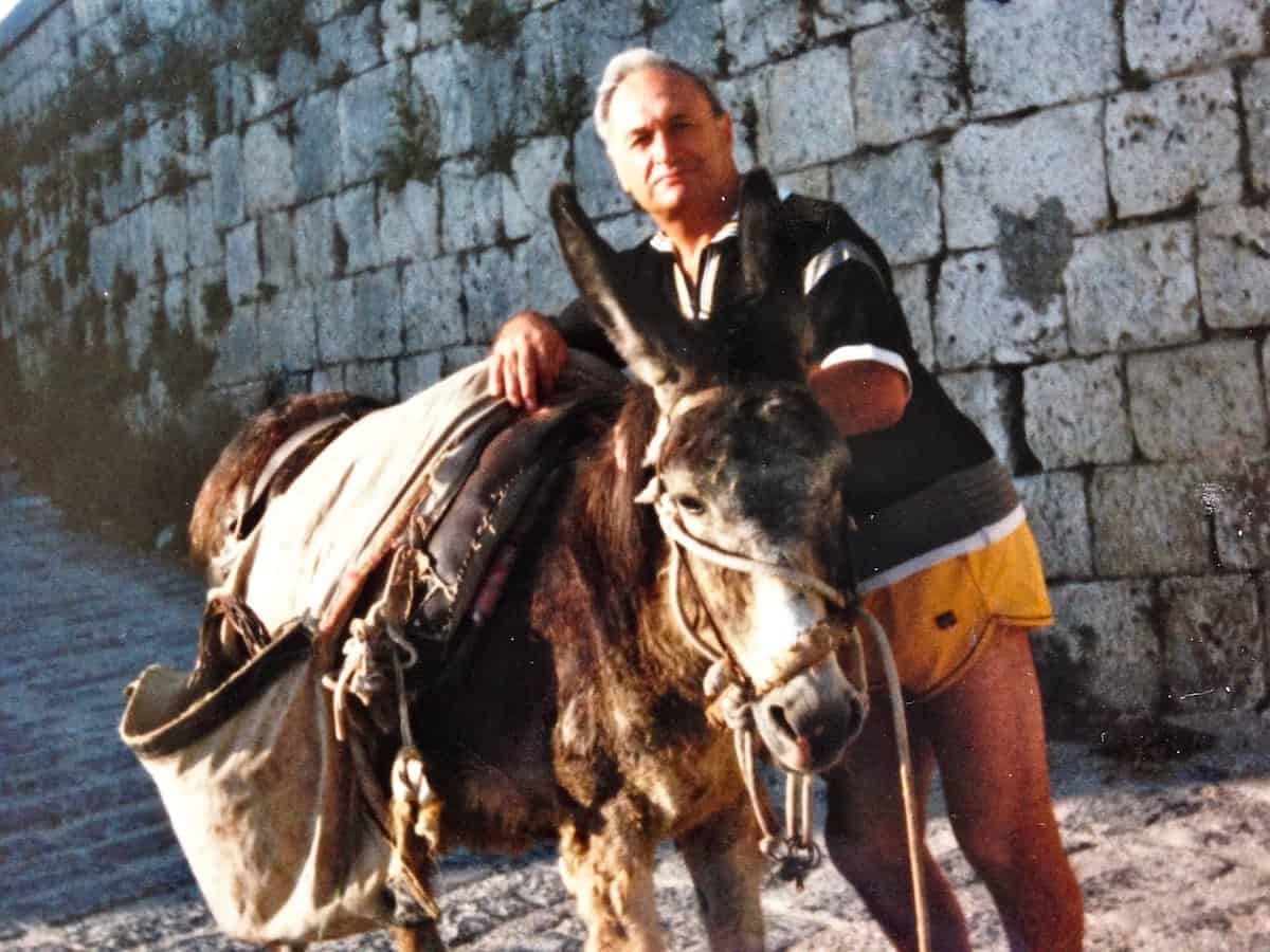 My dad in Sicily with a donkey