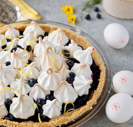 meringue kissed lemon pudding pie with wild berry jam