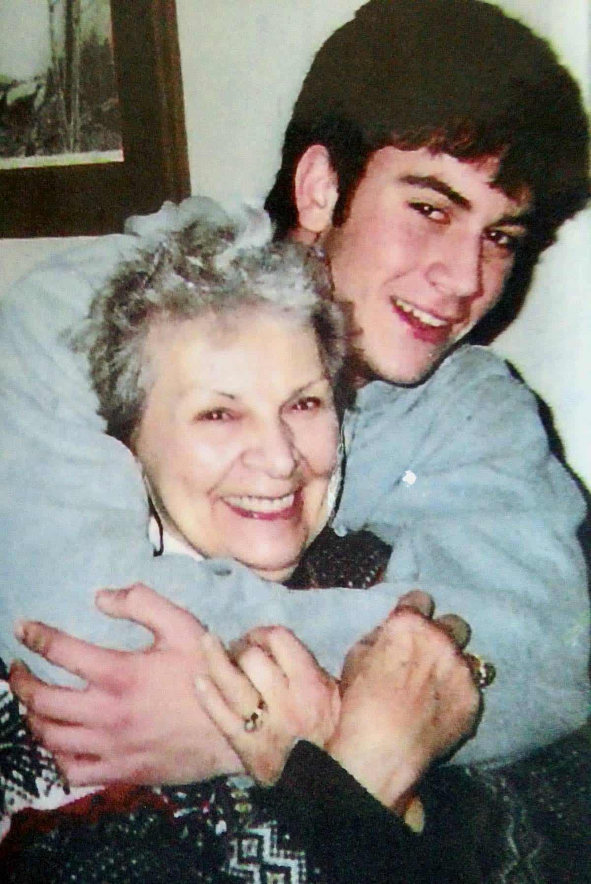 my son hugging his grandmother
