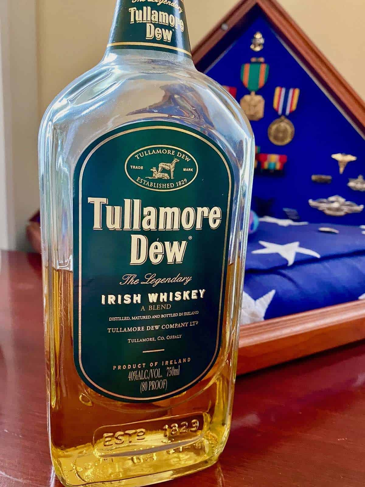 bottle of Tullamore Dew Irish Whiskey and folded American flag