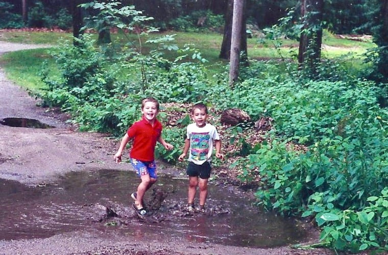 Will and friend playing in a mud puddle