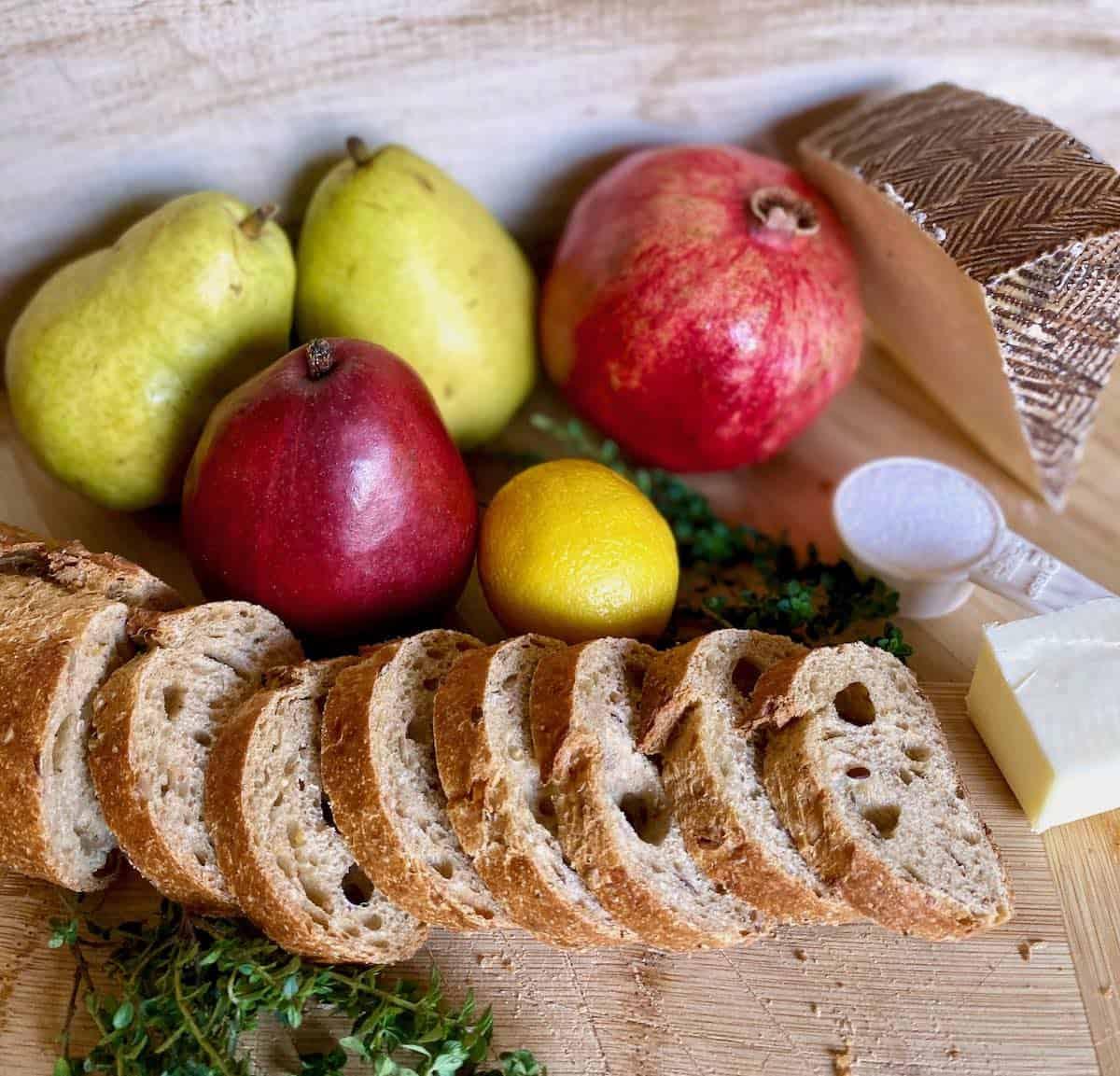 pear crostini recipe ingredients: pears, bread, cheese, pomegranate, thyme, sugar, lemon