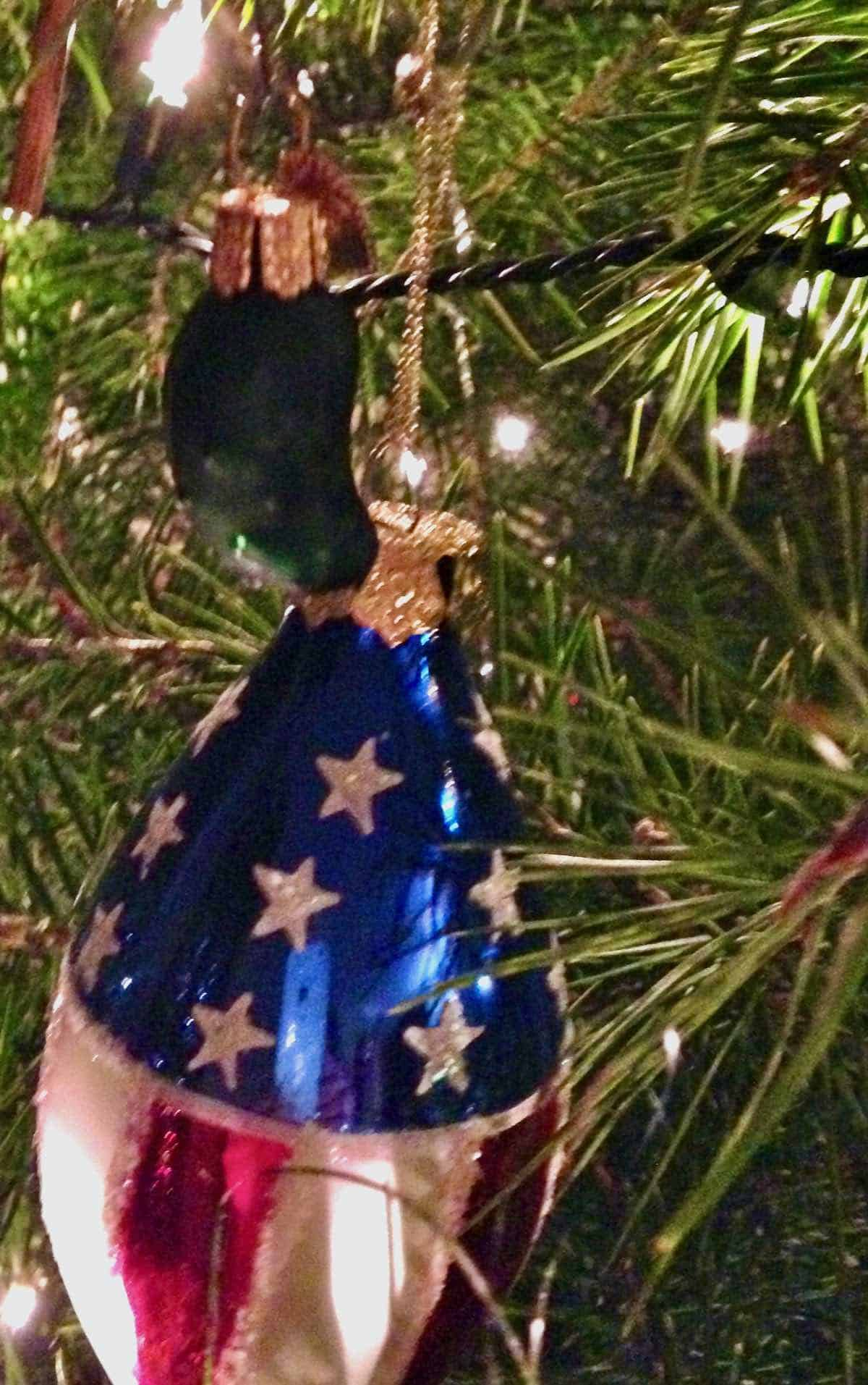 pickle and American flag xmas ornaments on tree
