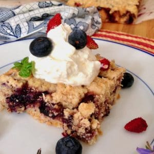 perfect 4th of July dessert shortcake bar topped with whipped cream and berries
