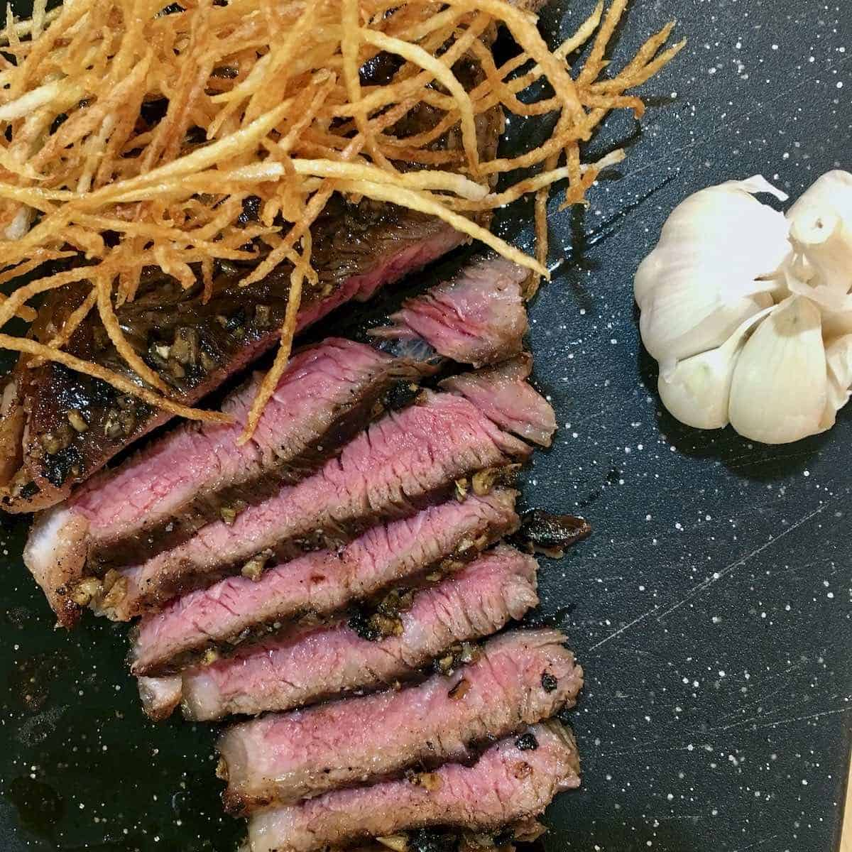 steak and fried shoestring potatoes