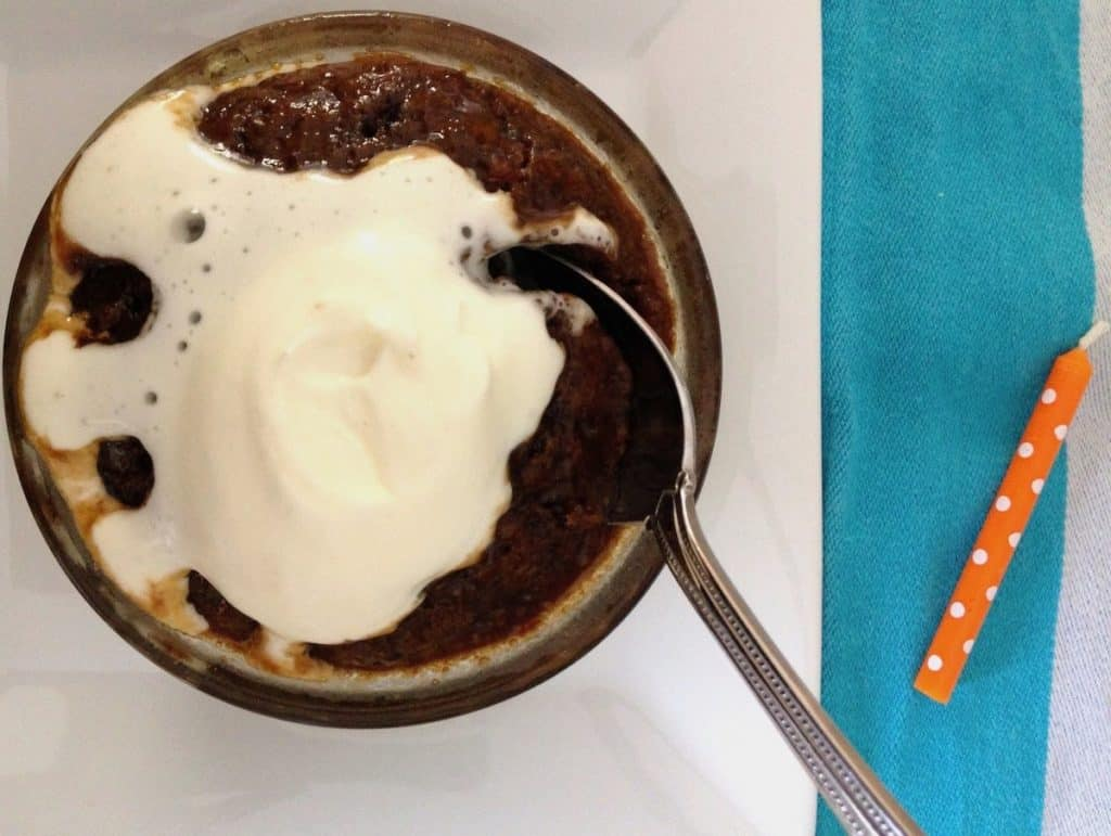 sticky toffee pudding with cream on top