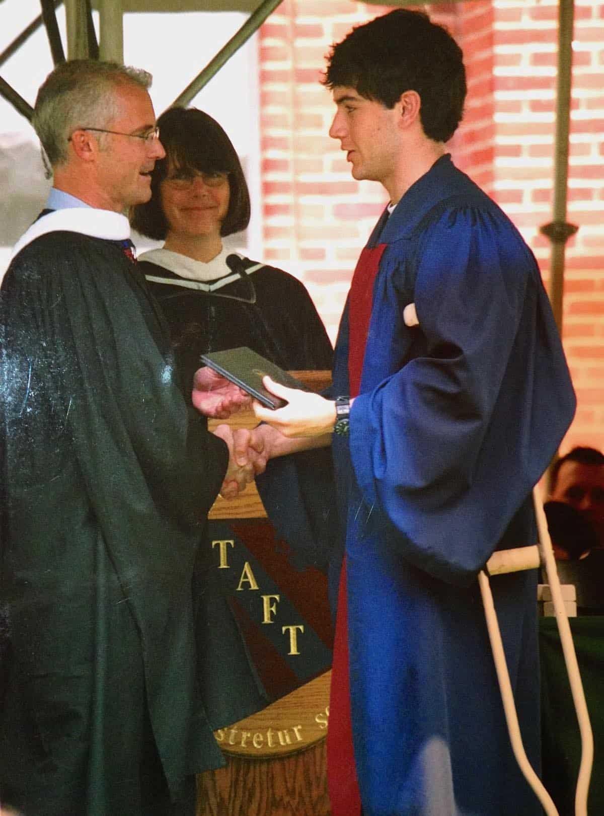 accepting his diploma