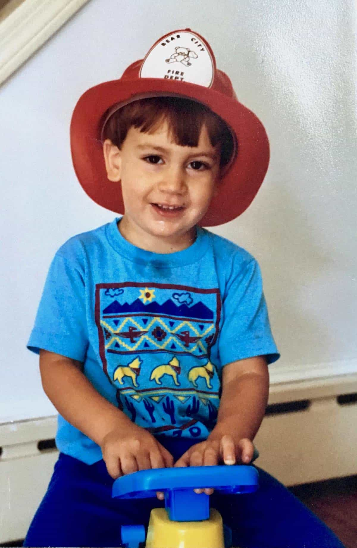 toddler William wearing a fireman's hat