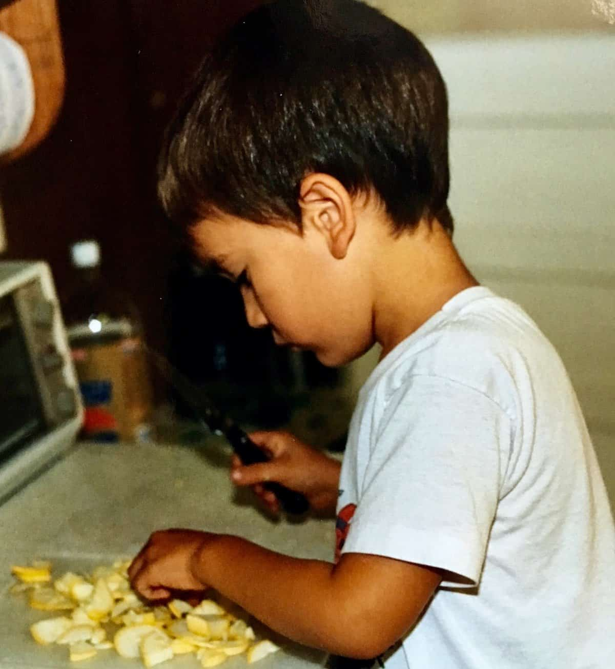 William as a toddler doing some cooking