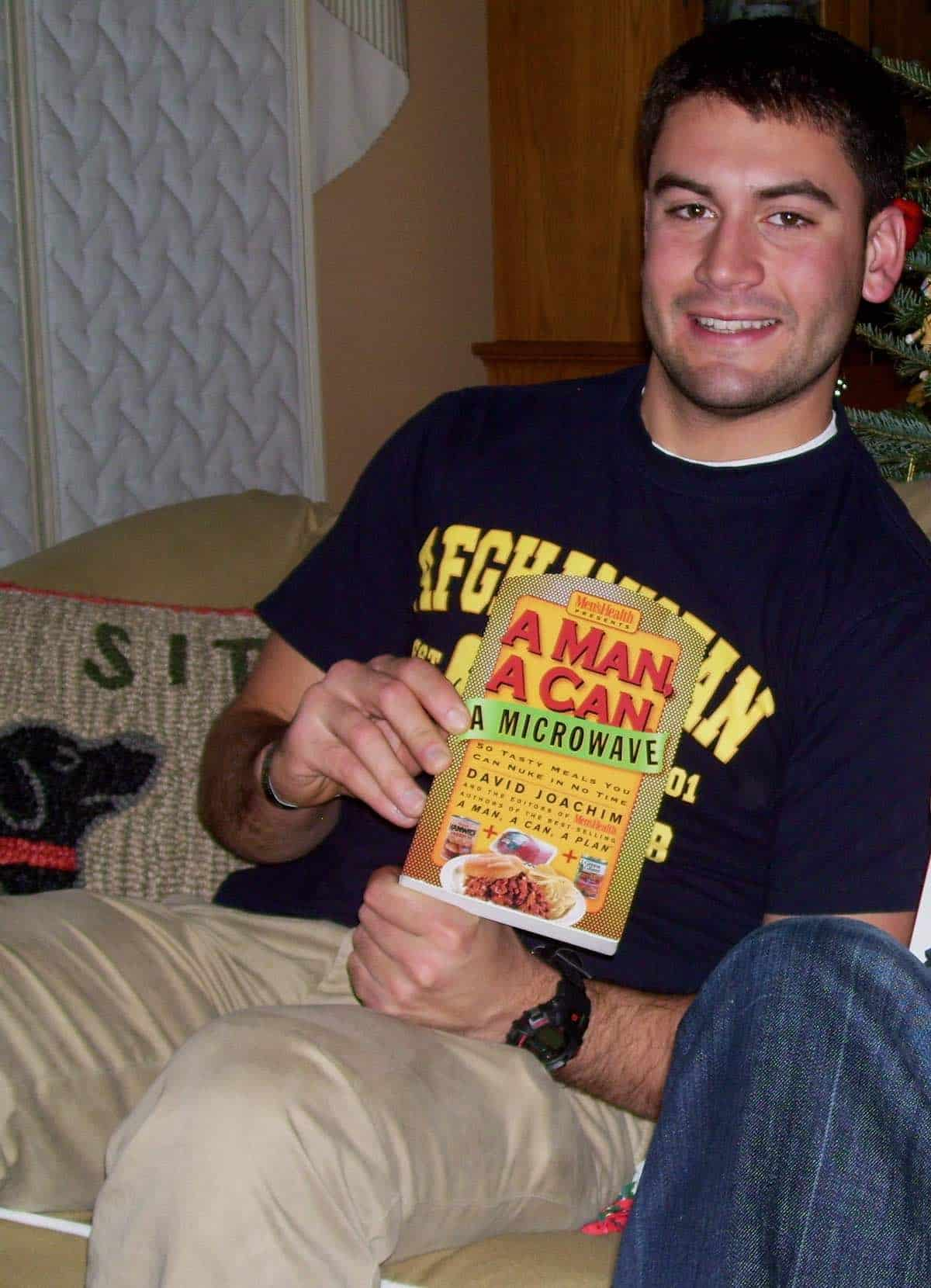 my son holding a cookbook