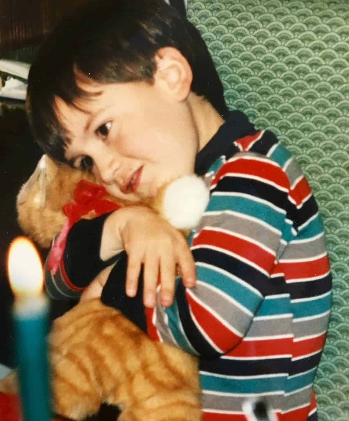 young William hugging his kitty