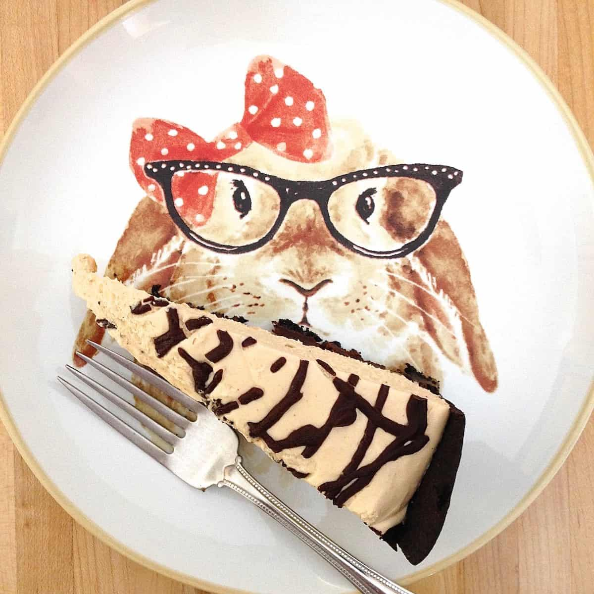 looks like me, doesn't it? slice of peanut butter turtle torte on plate painted with a lady rabbit wearing glasses