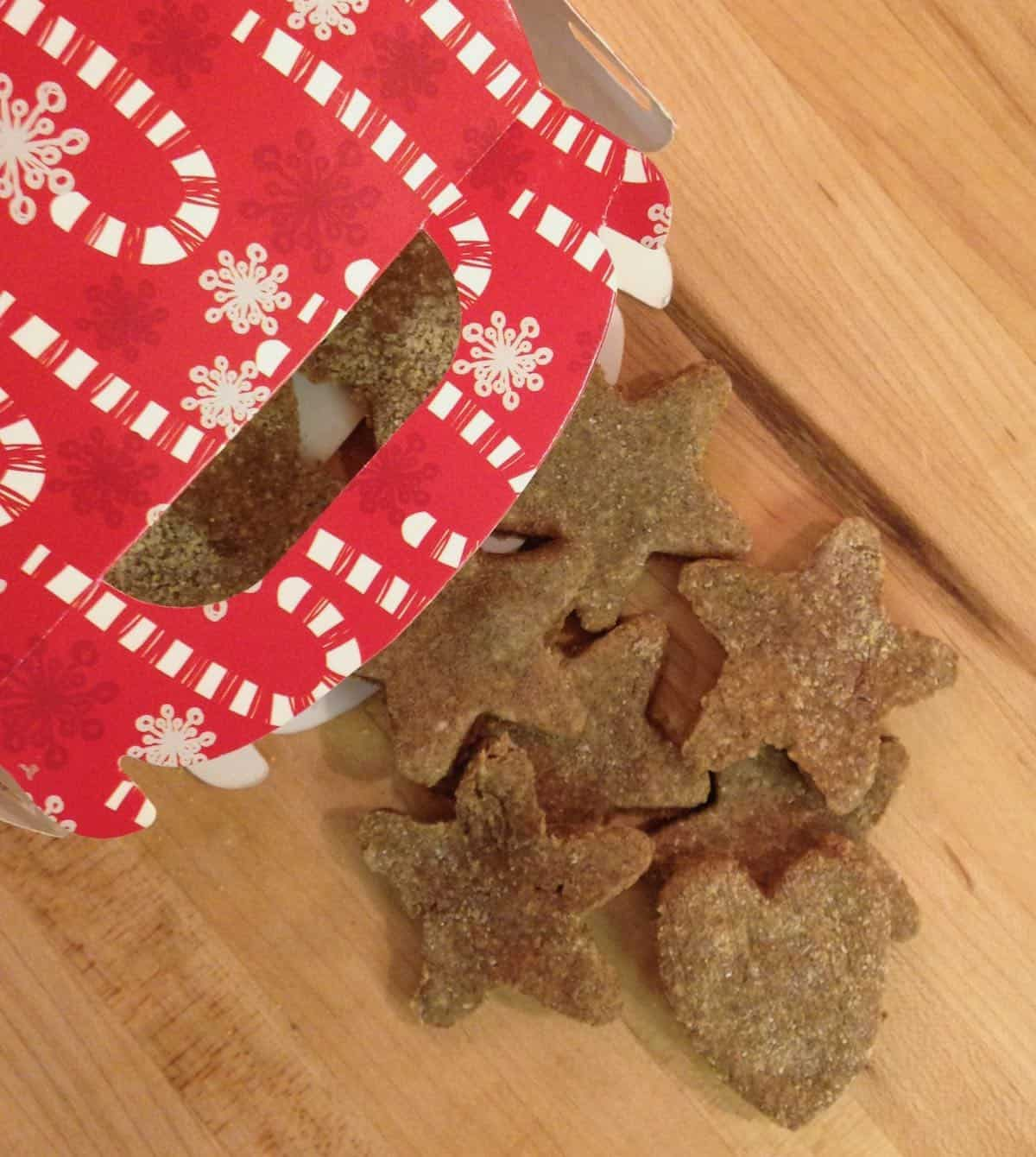 grain-free dog biscuits shaped liked stars in a Christmas bag
