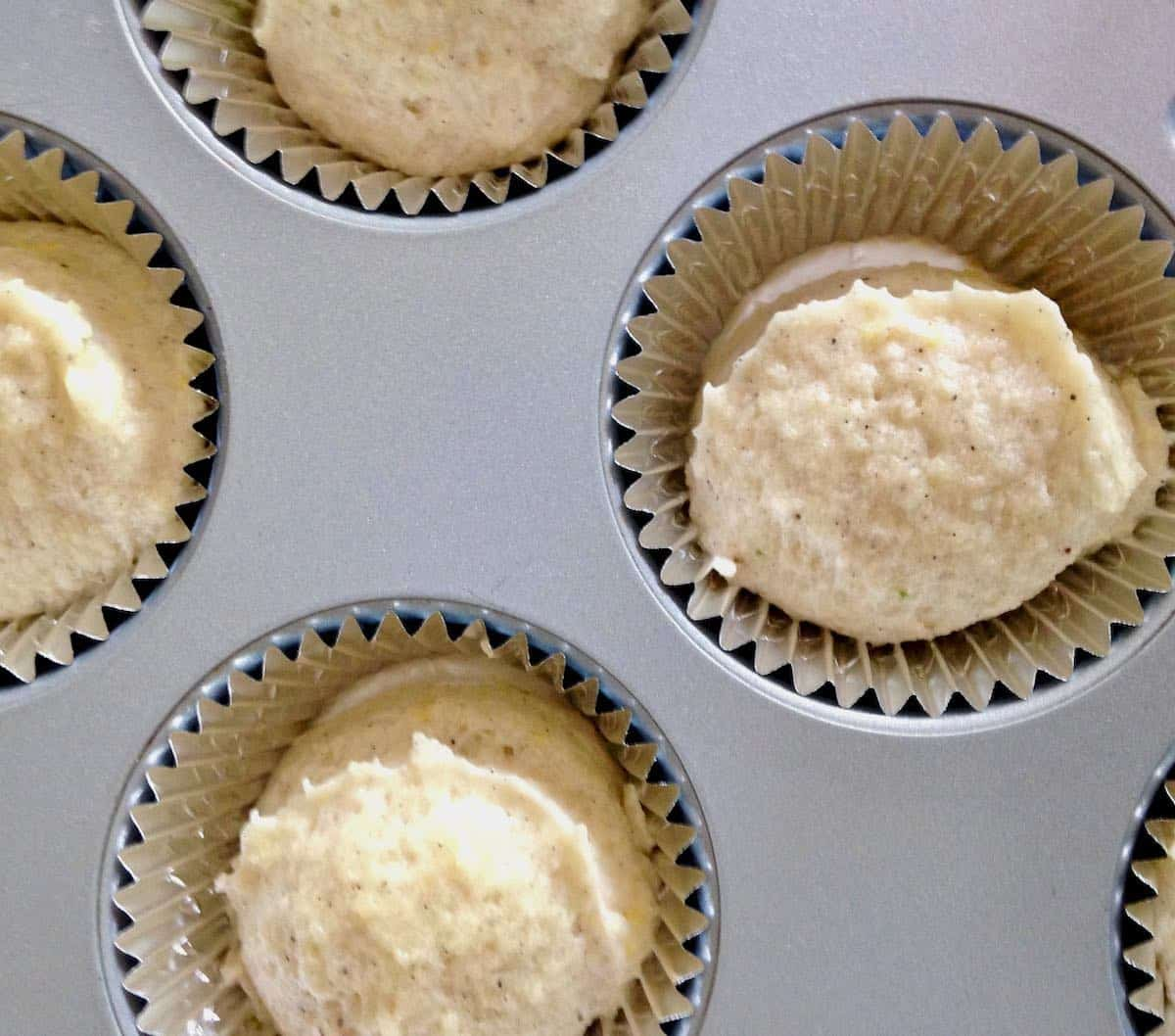 baked with butter--see the difference in the batter?  little blackberry almond cakes