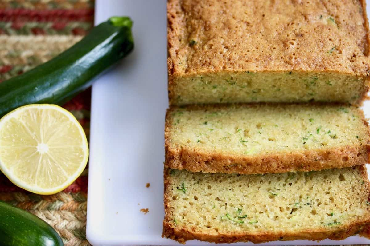sliced zucchini bread with fresh zucchini and lemon