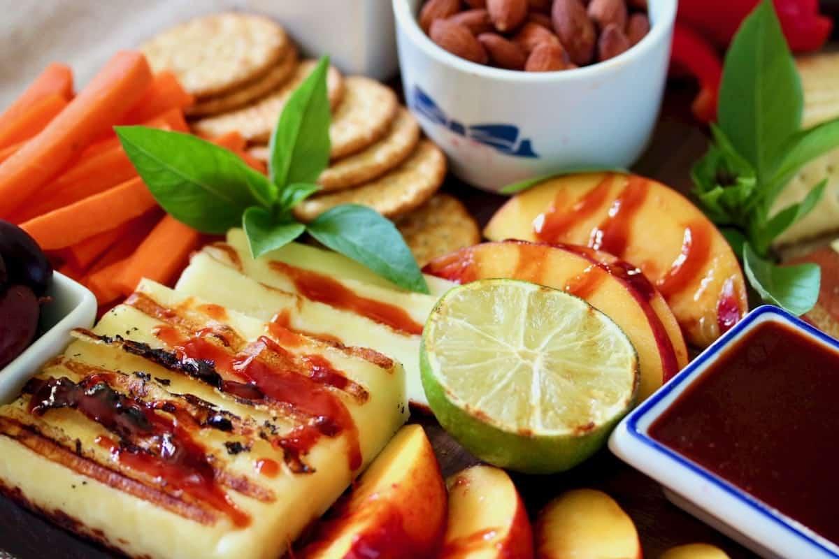 Healthier Holiday Cheese Board featuring gochujang glaze